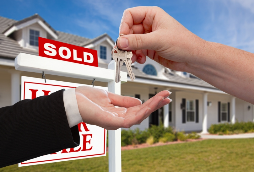 bigstock-Handing-Over-the-House-Keys-in-11942057.jpg